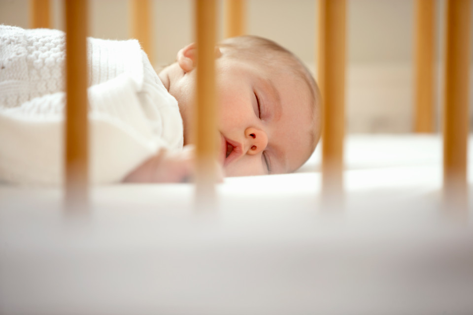 Is it safe for your baby to sleep in your bed? Experts reveal the risks of co-sleeping